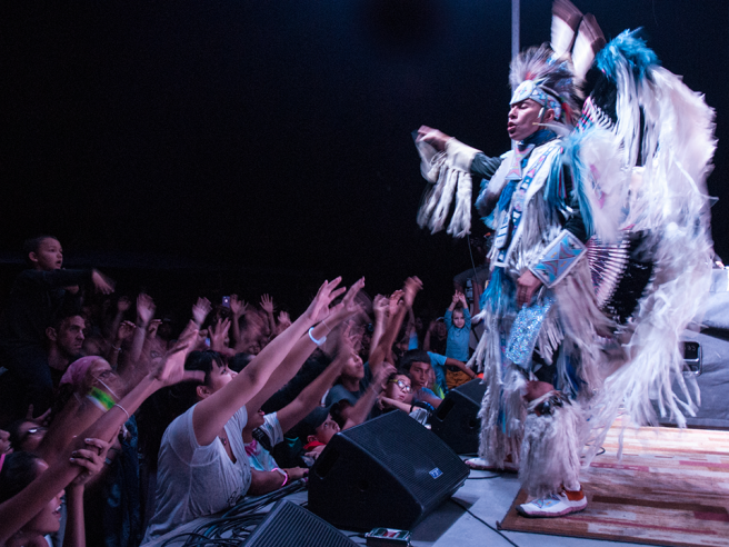 Image of Native American performer on stage.
