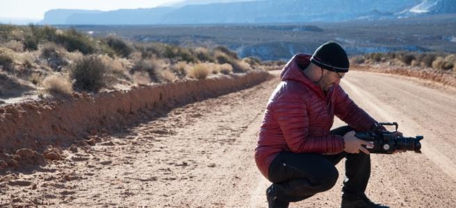 Image of fim crew in desert road.