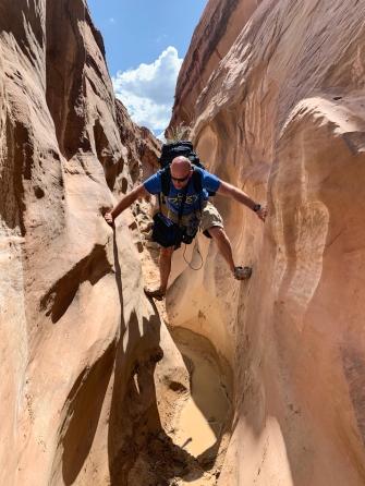 Image of man climbing through canyon